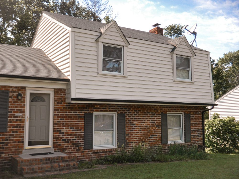 Before And After Photos Of A Siding Project On A Gambrel